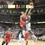Derrick Rose blocks a shot by Atlanta's Jamal Crawford
